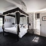 The Cordillero bedroom at Midlands Villa has a four poster bed