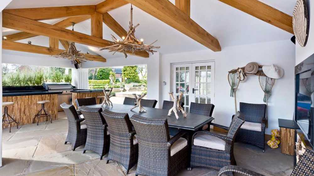 Groups enjoy the outdoor kitchen and dining area of this large house near Birmingham