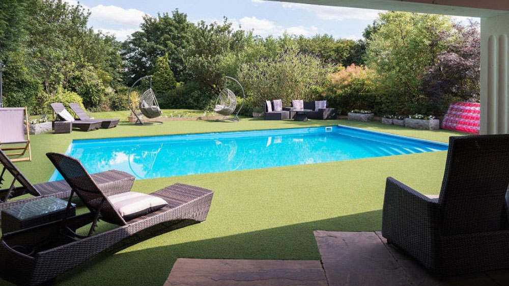 The secluded, sheltered swimming pool at Midlands Villa is very popular with for large family holidays.
