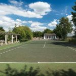 This large party house benefits from a tennis court for groups to enjoy while staying at the house