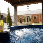 The large hot tub at Cliff Barns is within the central courtyard and is a big hit with our large groups