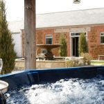 The large hot tub in the courtyard garden.
