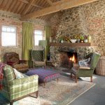 The open log fire and large comfortable sofas are ideal for winter weekends in Norfolk.
