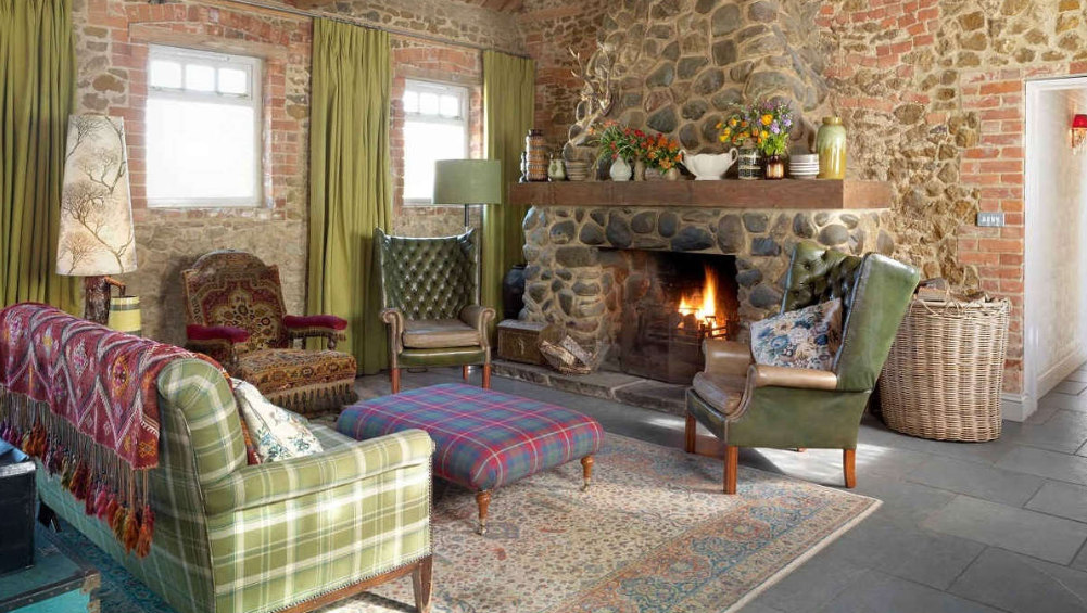 This snug area at our big house in Norfolk has a roaring log fire and comfortable seating