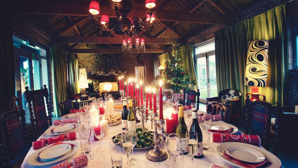 The dining area has a large table for all 18 guests to enjoy a candlelit lunch on Christmas Day