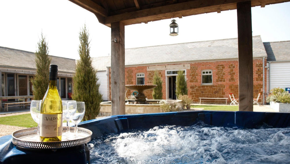 Cliff Barns in Norfolk has a large hot tub in the central courtyard garden