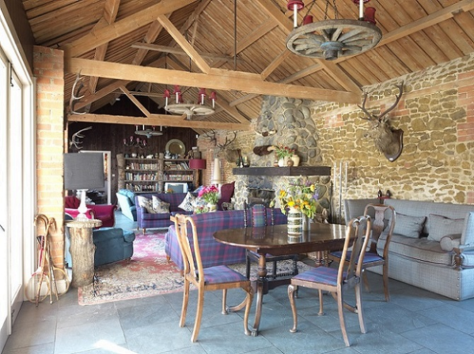 Exposed wooden beams and brickwork in the sitting and dining area at Cliff Barns in Norfolk