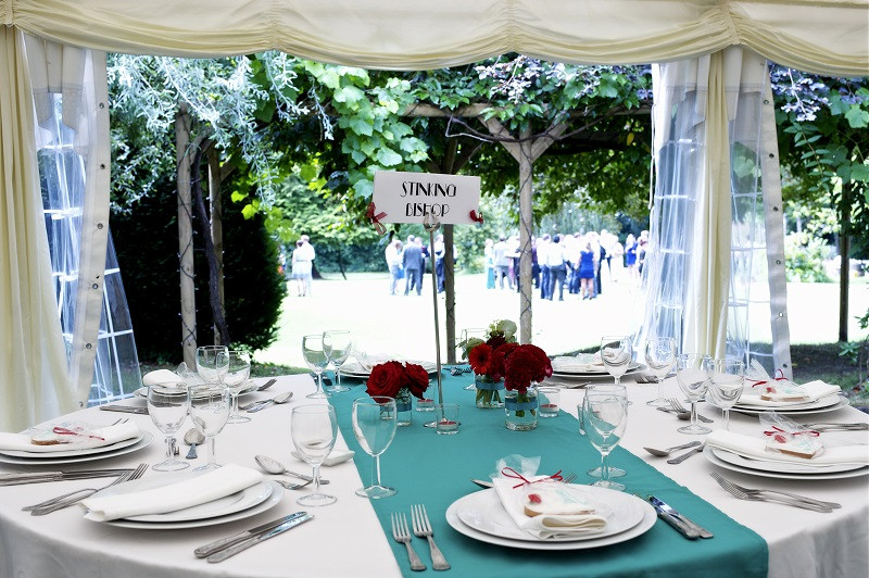 A summer marquee wedding at Tone Dale House with guests enjoying drinks on the lawn after the wedding ceremony.