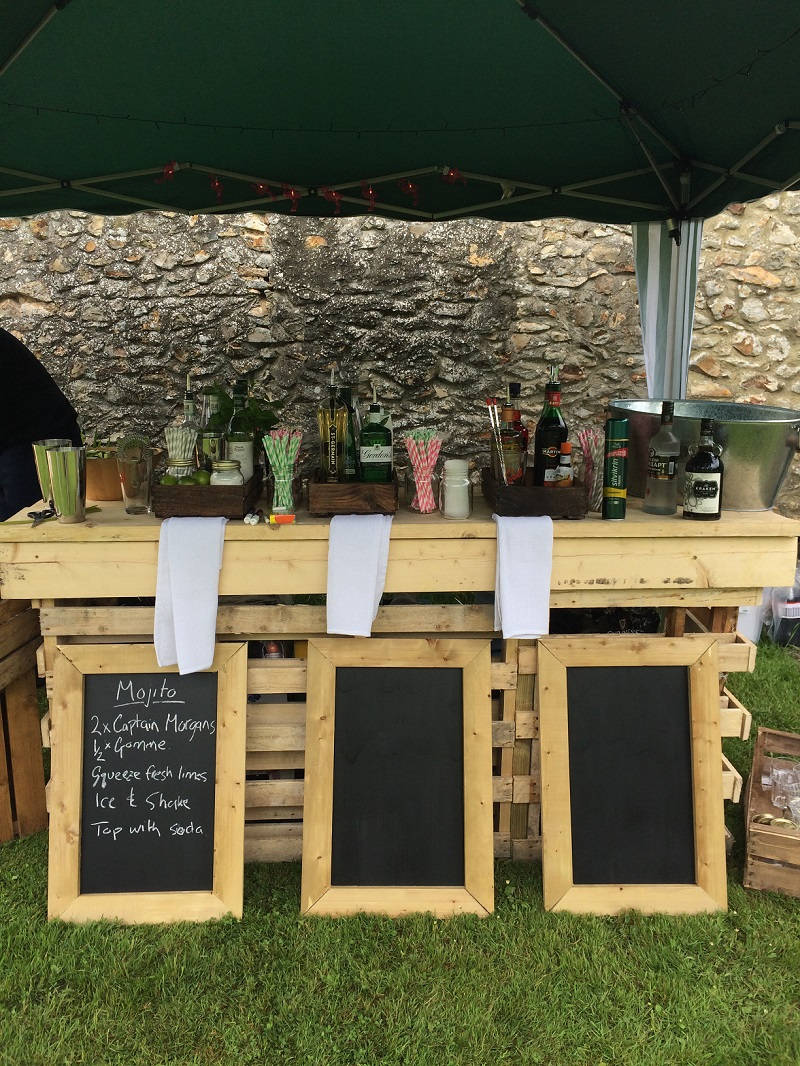 An outdoor bar at Widcombe Grange in Somerset, ready for wedding guests to enjoy cocktails at the wedding reception.