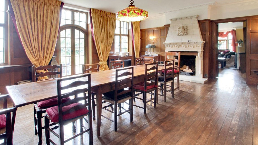 This country manor house in Sussex has an oak paneled dining room for up to 16 guests.