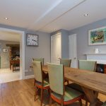 Pretty pale grey walls and a wooden floor in the charming breakfast room at Dorset Lodge