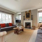 The sitting room at Dorset Lodge is delightfully cosy in the winter time with the log fire roaring.
