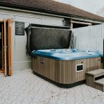 The large hot tub sits beside the games room at Dorset Lodge.