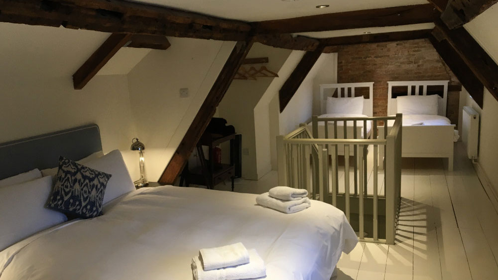 A spacious attic bedroom for large family groups at Dorset Lodge.