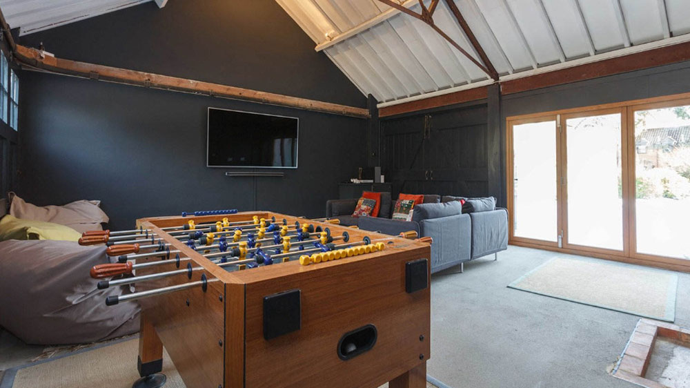 The large games room with table football and widescreen tv at Dorset Lodge.