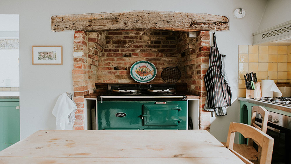 Our big house in Dorset has a country style kitchen with an Aga.