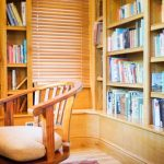 The small library has a secret doorway from the oak panelled hallway at Tatham House