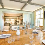 This party house in Somerset has a dining area with mood lighting and a large oak table