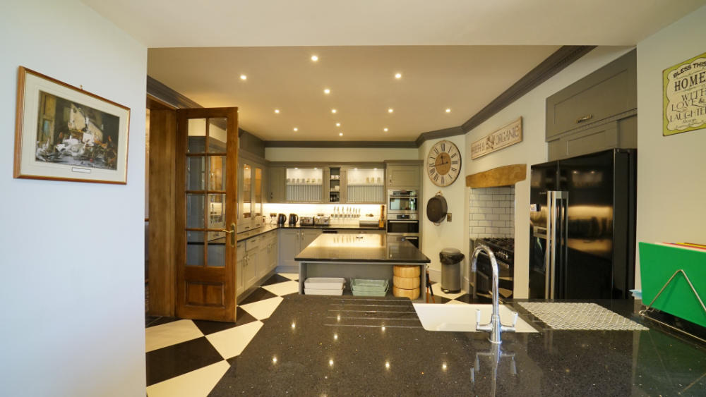 This stylish kitchen has everything needed for a large house party, including a range cooker and 2 dishwashers