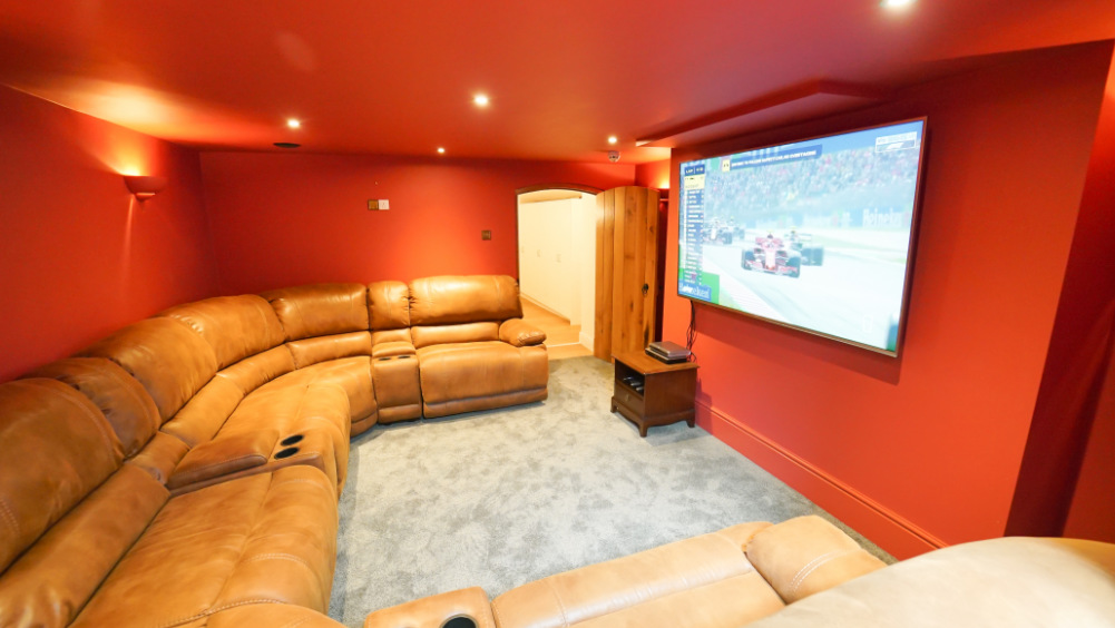 The lower ground floor at Tatham House in Somerset has a cinema room with wide screen tv, pool table & table tennis