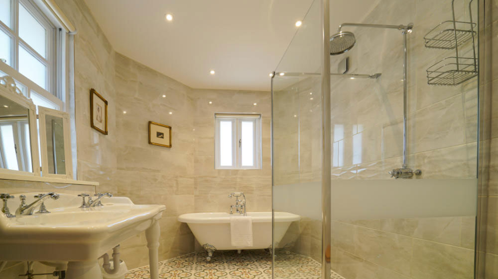 Stylish, fully tiled en-suite with bath and shower at Tatham House, Somerset