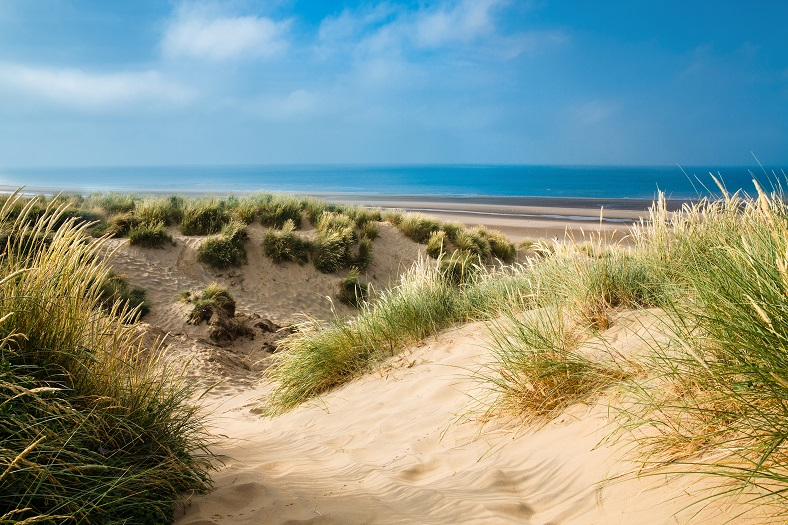 Camber Sands is a wonderful stretch of beach to enjoy as part of a weekend break at Sussex Manor, near Robertsbridge