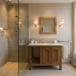 Large walk in shower in this spacious bathroom
