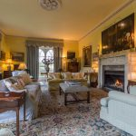 The sitting room of this country mansion is spacious and comfortable.