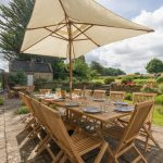 The large garden and dining area at our big house in Somerset.