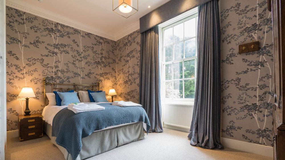 Large light filled bedroom at Ilminster Manor