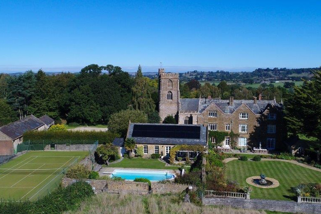 This aerial view of our big house in Somerset shows its pool and location.