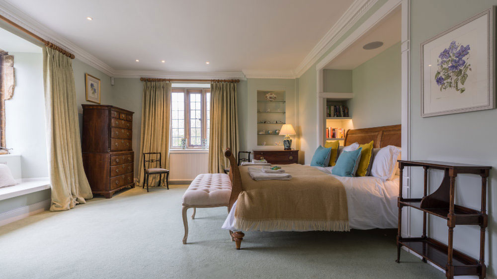A beautifully furnished large bedroom at Ilminster Manor