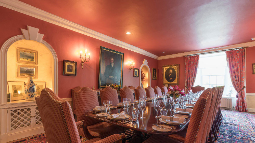 The large dining table at Ilminster Manor seats all 24 guests comfortably
