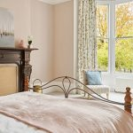 The bedrooms at this big house are spacious with lovely windows and views.