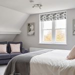 Beautiful textiles and pale paintwork in this bedroom at our big house near Cheltenham.