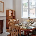 The sunny breakfast room is perfect for a big group of family or friends.