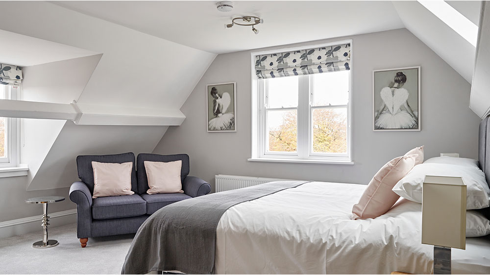 Guests of The Big House Company love the attic bedrooms with its large bed and seating area.