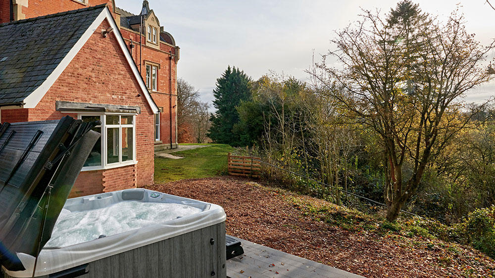 The hot tub is popular at this big house, with its views over the countryside.