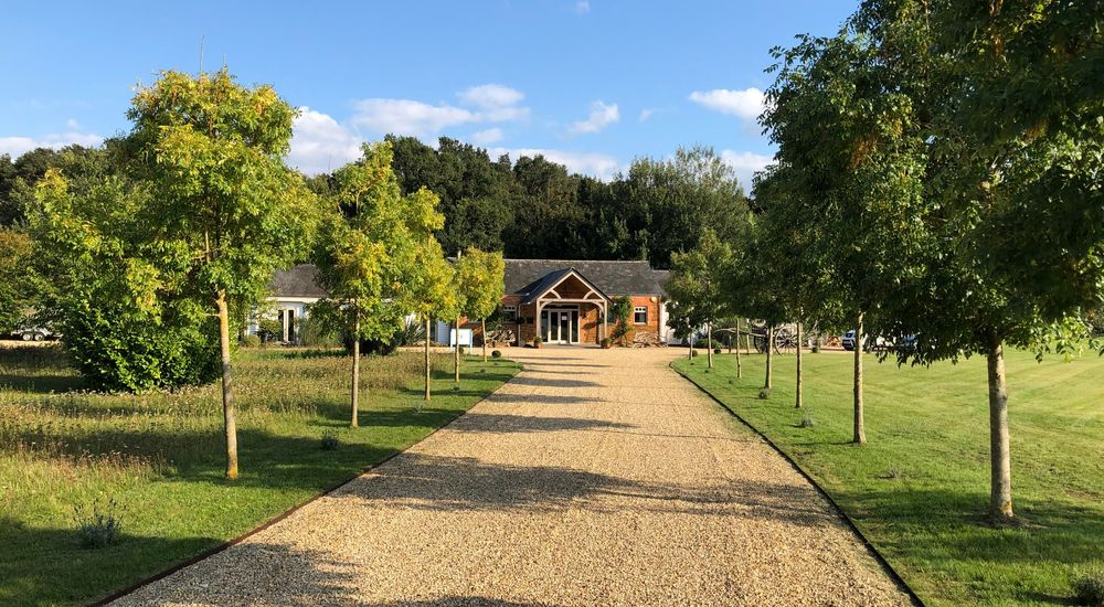 A lovely approach to this Norfolk barn along a tree lined, sweeping driveway